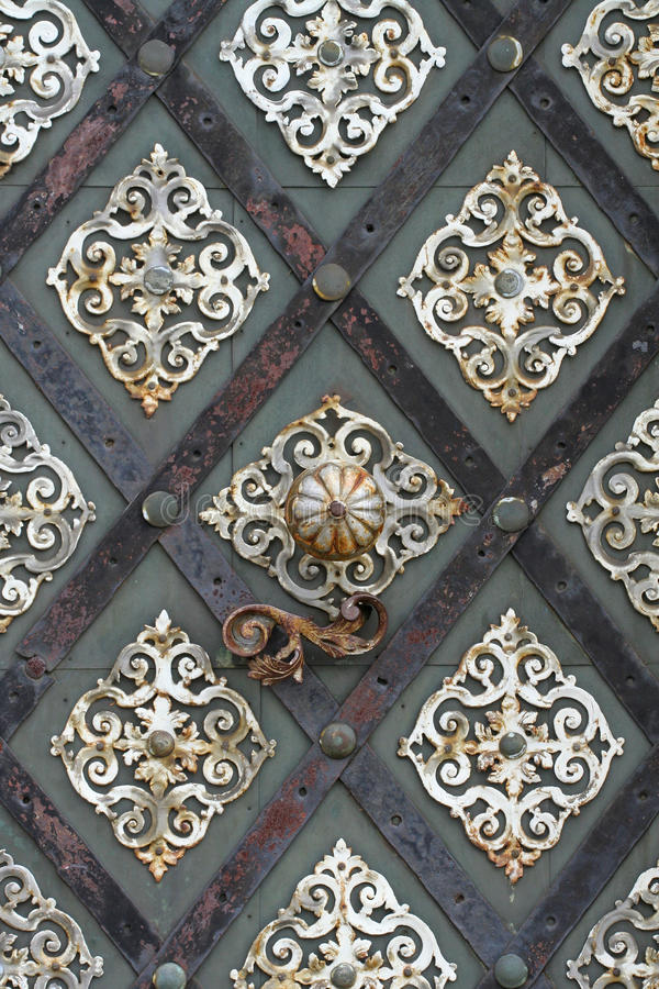 Old cathedral metal door in detail royalty free stock photos