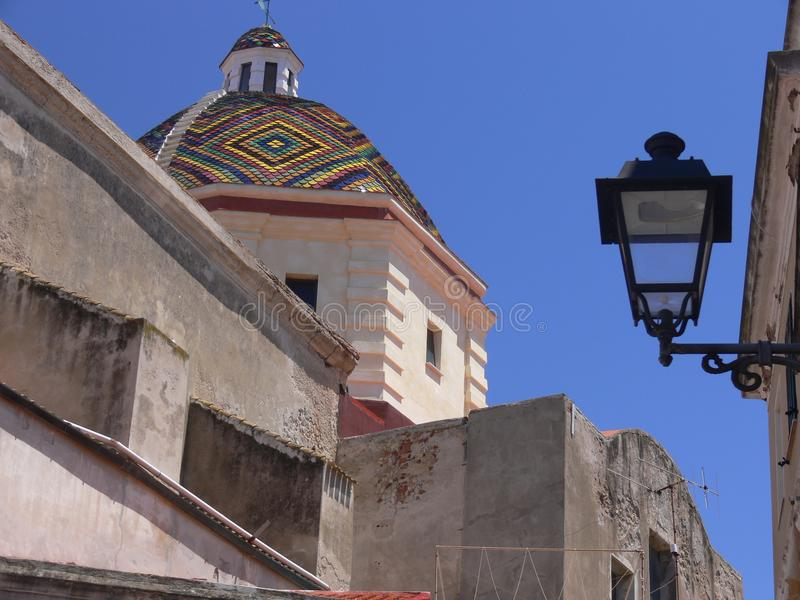 Old church in sardinia with beautiful colorful domed roof stock image