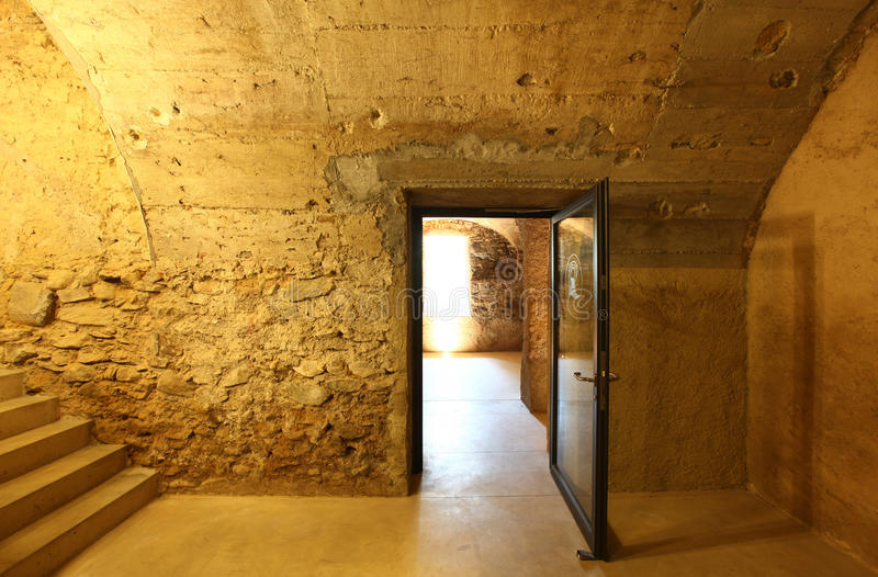 Old cave, modern door stock photography
