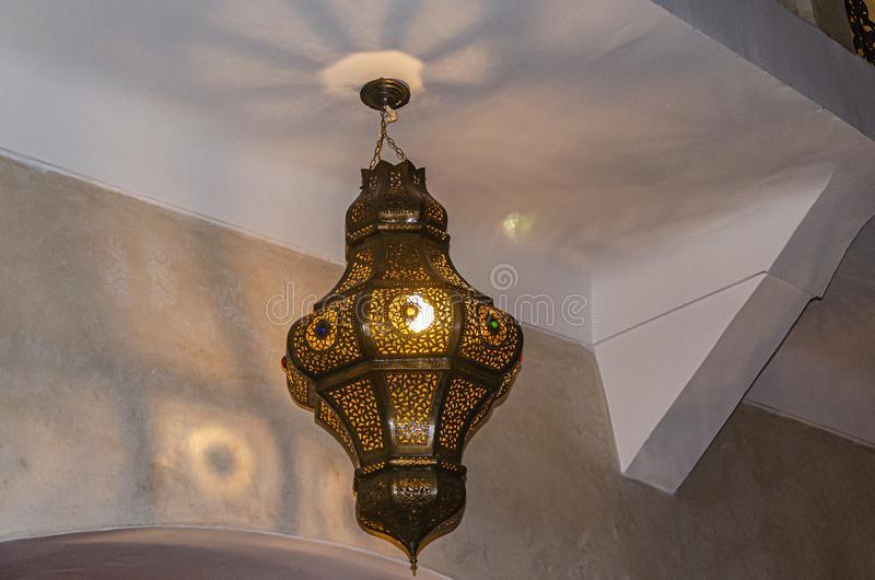 Arabic ceiling lamp with decorations.marrakesh morocco royalty free stock photo