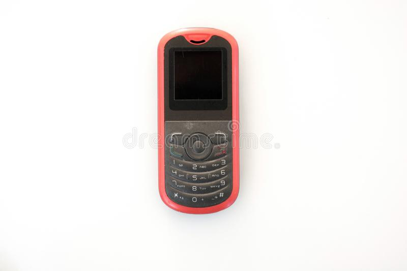 Old cell phone on white background royalty free stock images