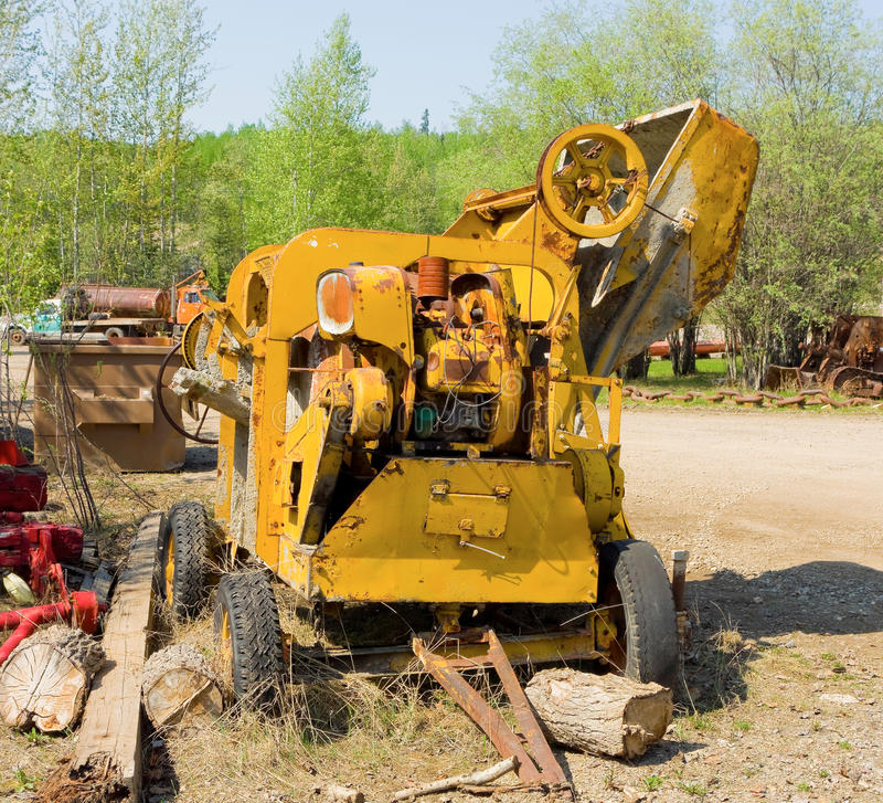 An old cement mixer on display at an outdoor museum in fort nelson, bc stock photography