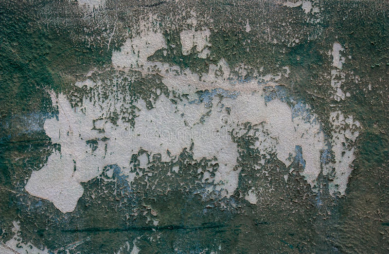 Old cement wall and paint peeling off the walls. stock photos