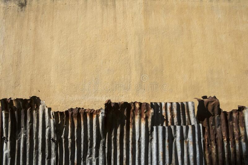 Old cement Wall yellow and zinc up rust wallpaper royalty free stock images