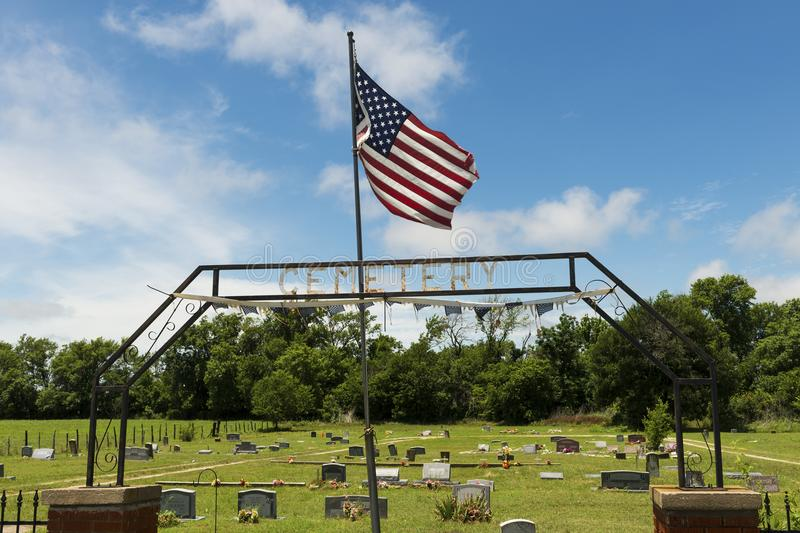 Old cemetery with the American Flag at the entrance in the State of Texas, USA stock images