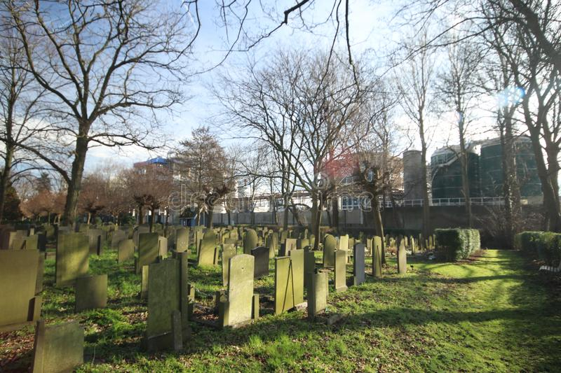Old cemetery of Gouda behind the Croda factory where last person burried was in 1971. Volentueers are maintaining it stock photo