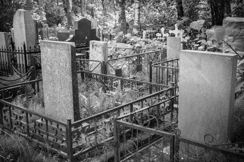 In the old cemetery there are graves with tombstones and crosses. Black and white image royalty free stock images