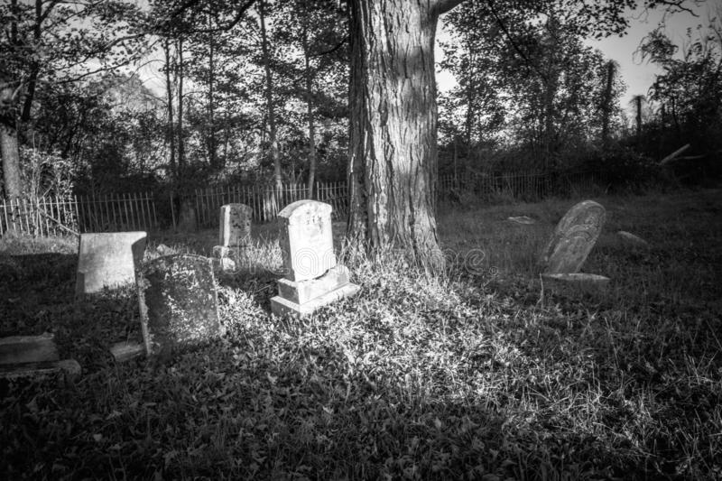 Old cemetery and tombstones in rural town, black and white. Old cemetery and tombstones in rural town of Wantage, NJ, from 1800`s, black and white royalty free stock images
