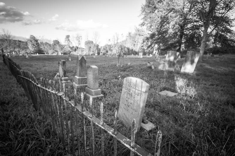 Old cemetery and tombstones in rural town, black and white. Old cemetery and tombstones in rural town of Wantage, NJ, from 1800`s, black and white stock photography