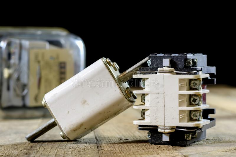 Old ceramic fuse holders. Old electrical accessories. Wooden tab stock images
