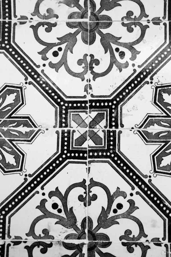 Old Ceramic Tile With Black And White Pattern Stock Image