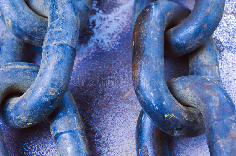 Old chain and links in blue. Close-up of large old chain and links stock photography
