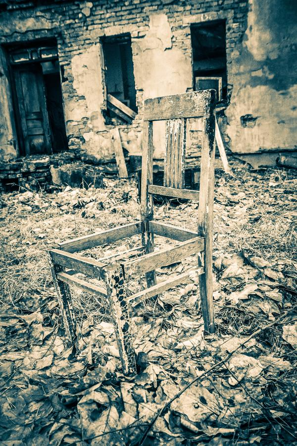 Old chair and abandoned house royalty free stock photos