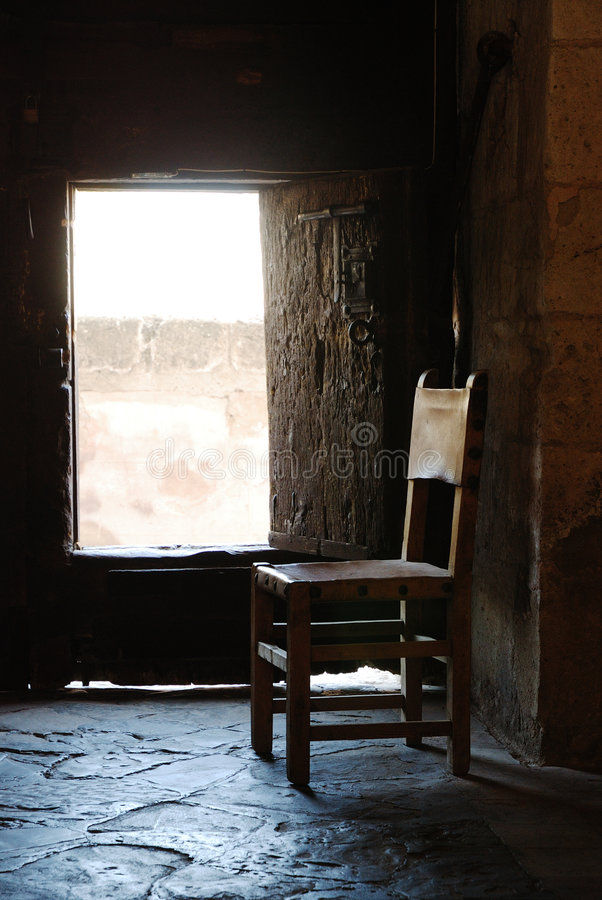 Old chair in shadows royalty free stock photo