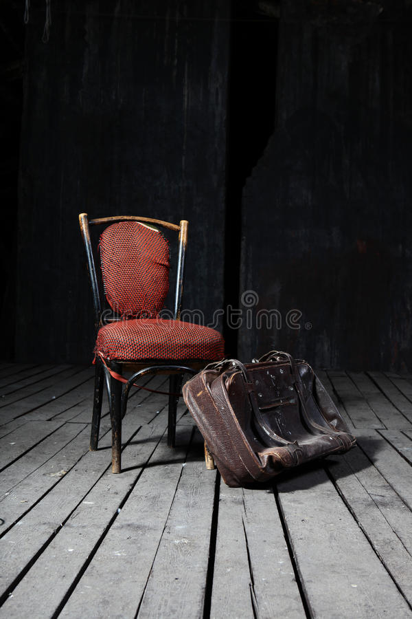 Old chair and suitcase stock photography