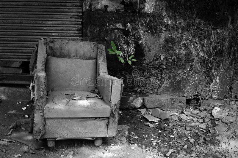 Old chair where no one will sit. Aged unnecessary things (warhorse), wear process. Old chair where after half century of life no one will sit. Retro mood royalty free stock image