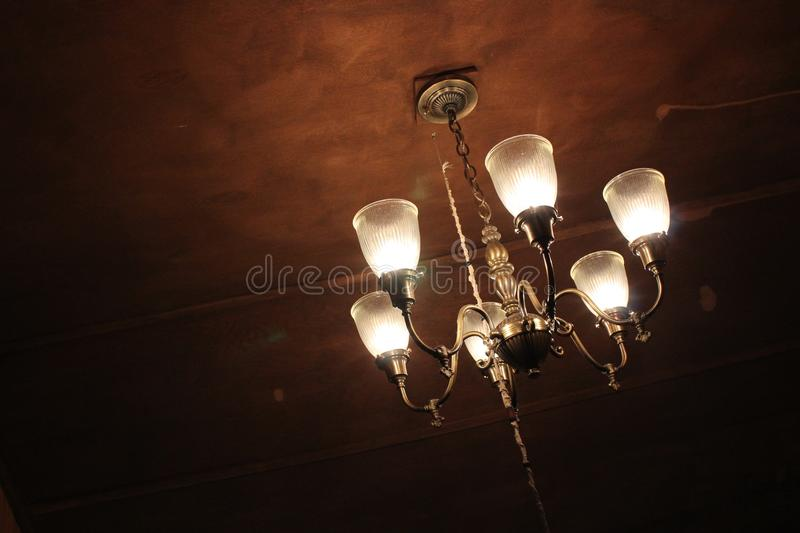 Old Chandelier in Darkened Room royalty free stock images