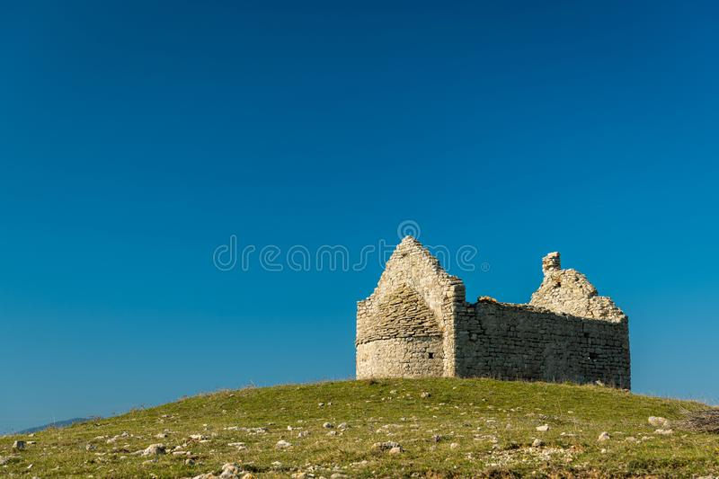 Old chapel standing on a hill in Cres royalty free stock photo