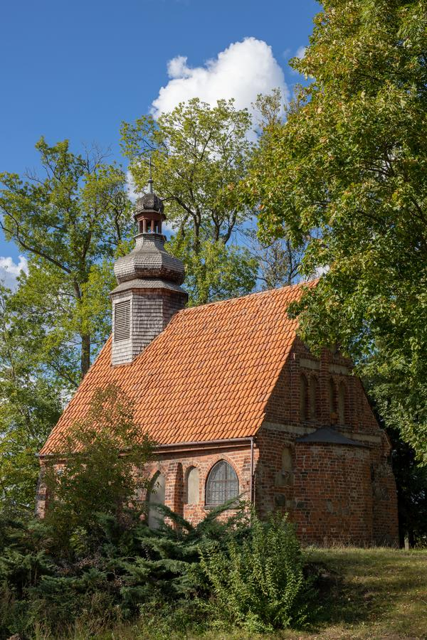 Old chapel with a wooden tower. A red brick church in Central Eu stock images