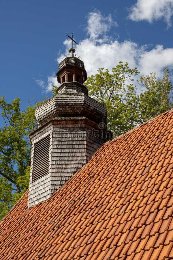Old chapel with a wooden tower. A red brick church in Central Eu stock photography