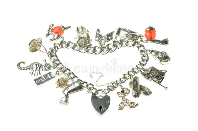 Old charm bracelet heart. An old isolated charm bracelet in the shape of a heart with padlock royalty free stock photography