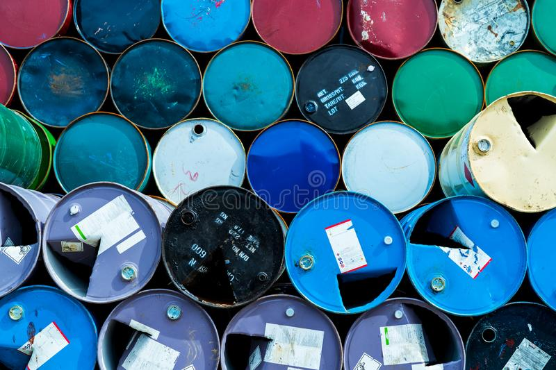 Old chemical barrels. Blue, green, and red oil drum. Steel oil tank. Toxic waste warehouse. Hazard chemical barrel with warning. Label. Industrial waste in royalty free stock image
