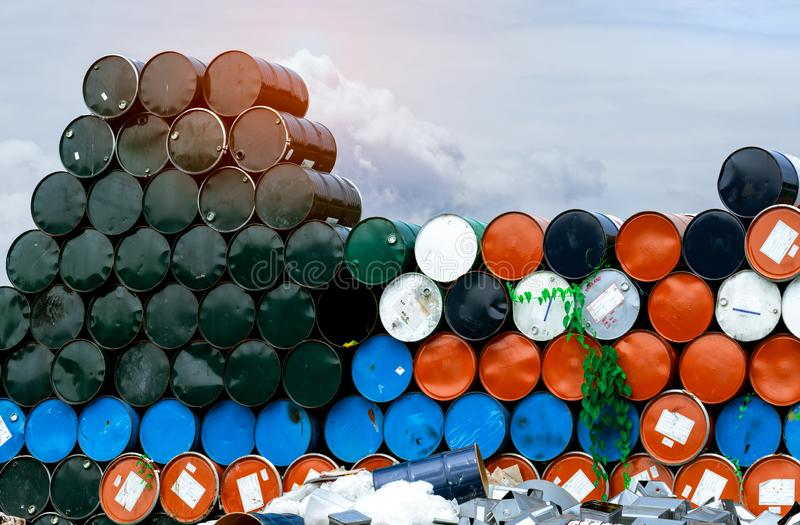 Old chemical barrels. Blue, orange, and black oil drum. Steel oil tank. Toxic waste warehouse. Hazard chemical barrel. Industrial. Waste in metal drum. Hazard royalty free stock images