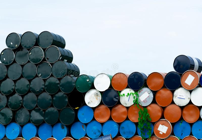 Old chemical barrels. Blue, orange, and black oil drum. Steel oil tank. Toxic waste warehouse. Hazard chemical barrel. Industrial. Waste in metal drum. Hazard royalty free stock photography