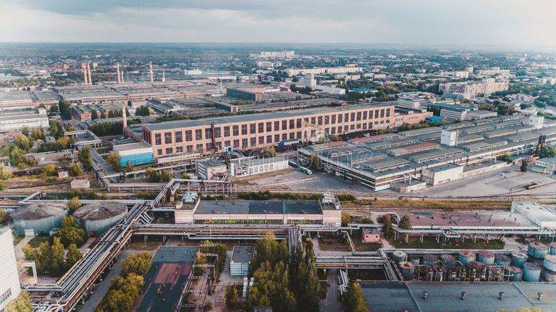 Old chemical factory. With oil storage tank, pipes and refinery workshop, aerial view stock images