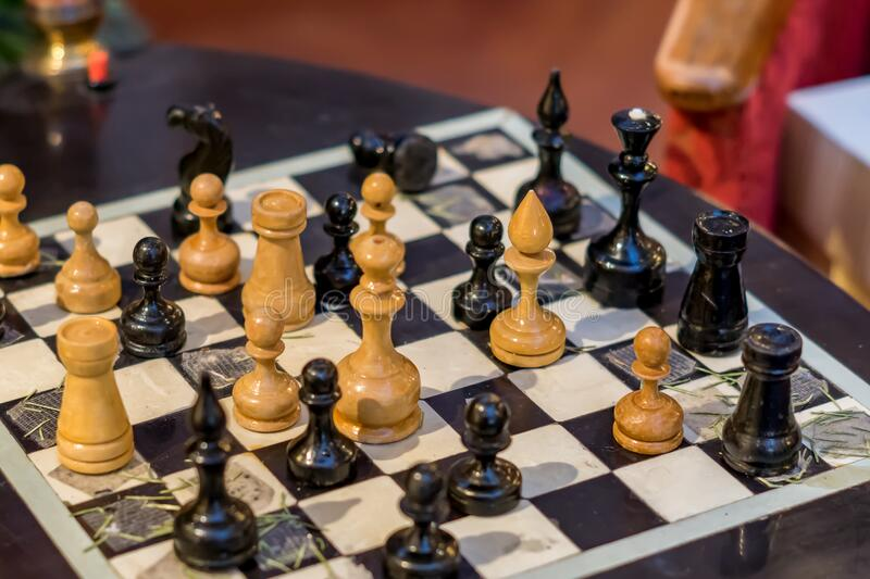 Old chess board with figures. Game for two people stock image