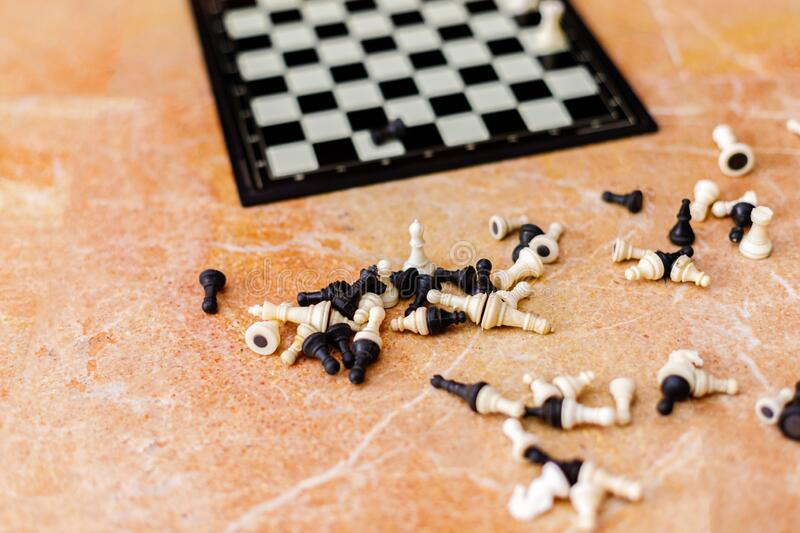 Old chess figures on marble background.  stock photography