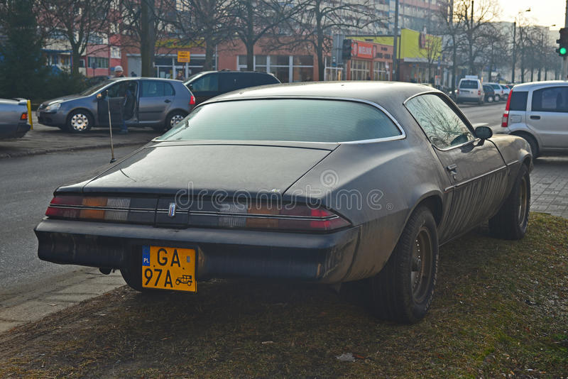 Old Chevrolet Camaro parked. Chevrolet Camaro parked near post communist blocks of flats in Gdansk, Northern Poland stock photos
