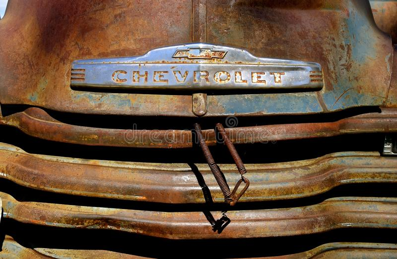 Old Chevrolet pickup with a hood logo stock images