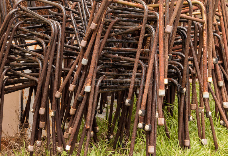 Old Chiar Legs. Old and rusted steel chair frames stacked up royalty free stock photography