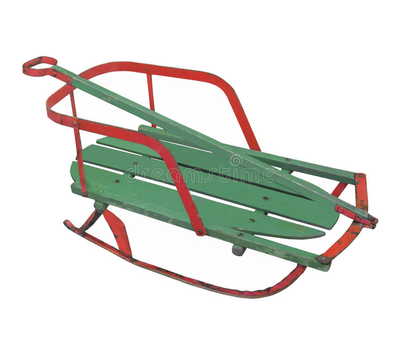 Old child's snow sled isolated. royalty free stock images