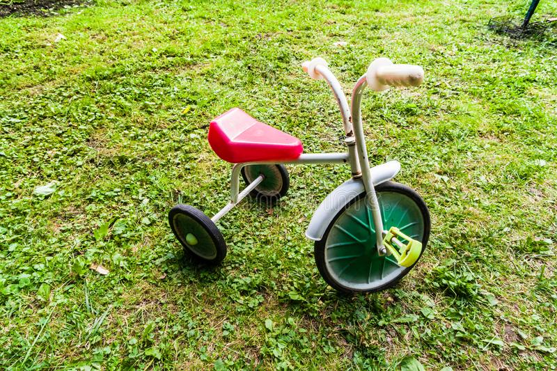 old childrens tricycle bike. Retro three-wheeled bicycle of the 80s royalty free stock image