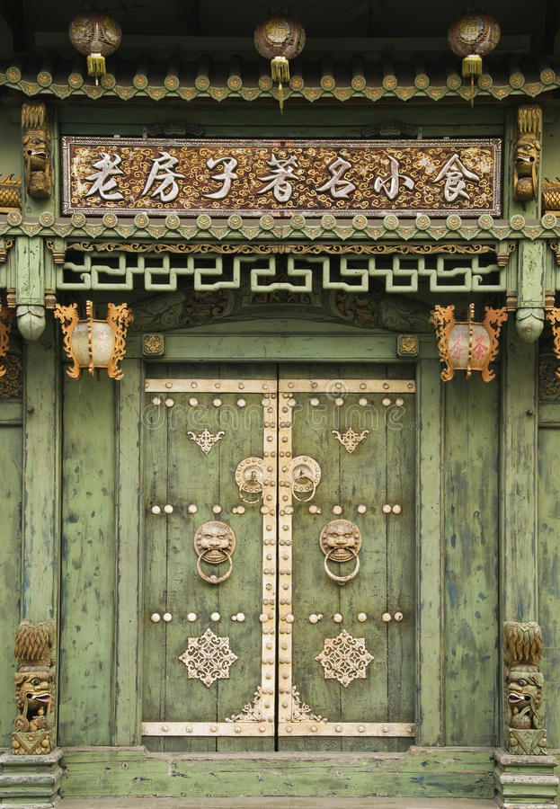 Old Chinese door, George Town, Penang, Malaysia. Old Chinese door with decorative lanterns, George Town, Penang, Malaysia royalty free stock photos