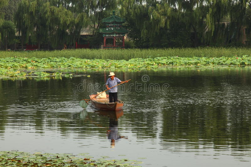 Old Chinese man in canoe royalty free stock photos
