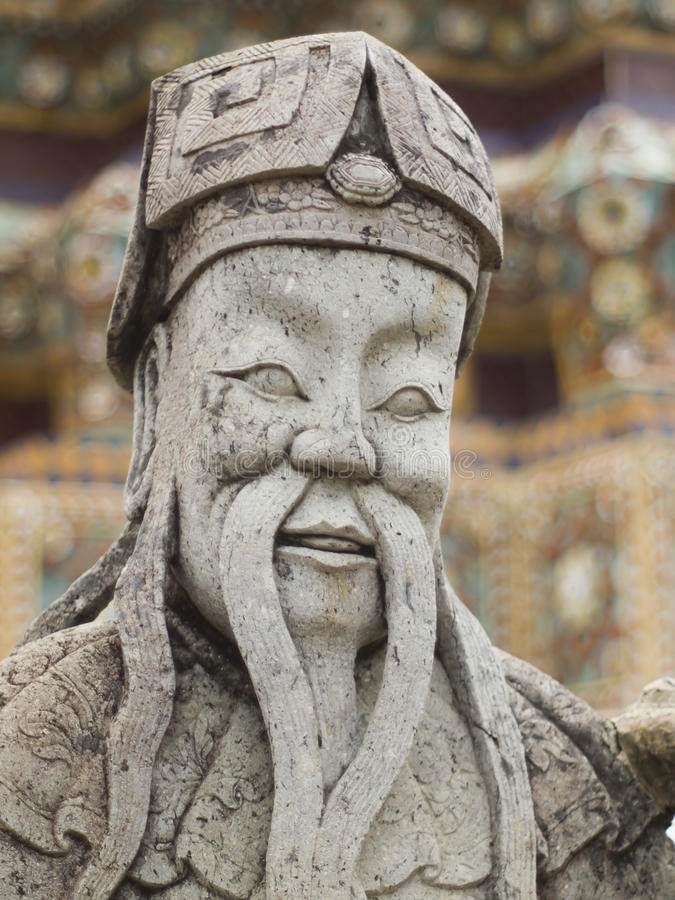 Old chinese man statue with moustache royalty free stock images