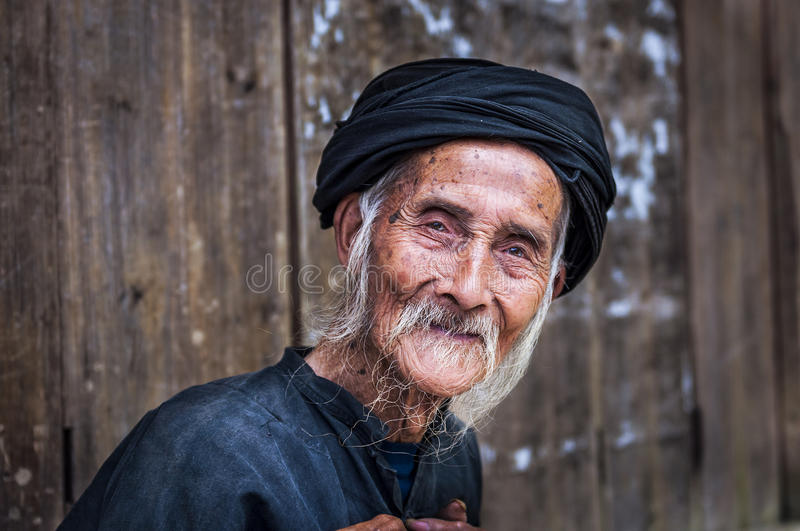 Old Chinese man wearing traditional clothes in Dazhai, Guangxi, China stock image