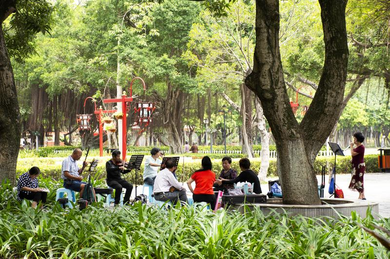 Old chinese people meet friends and sing song with playing classic musical instruments concert in park at Guangdong, China. Old chinese people meet friends and stock photos