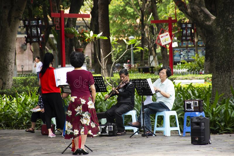 Old chinese people meet friends and sing song with playing classic musical instruments concert in park at Guangdong, China. Old chinese people meet friends and stock photo