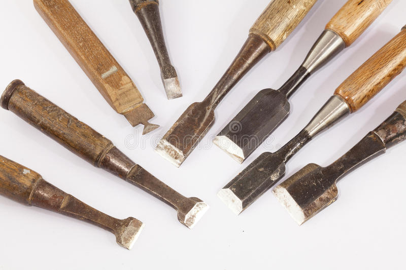 Old chisel. Old rusty chisel on white background stock photography