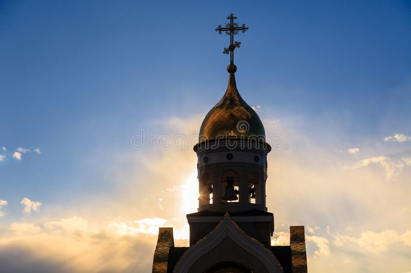 Old Christian church in Kemerovo with golden and gilded domes, b. Old Christian chapel in Kemerovo with golden and gilded domes, brown granite walls against a royalty free stock photography