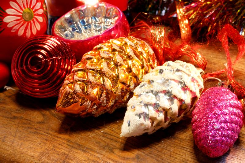 Old Christmas tree decorations on wooden surface. Vintage Christmas tree trinkets in different colors lined up on a wooden surface. Slightly blurred background stock photo