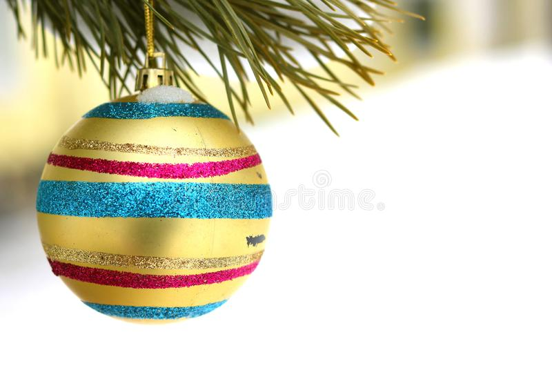 Old Christmas tree toy. Old vintage Christmas tree toy in retro style on pine branch in winter royalty free stock images