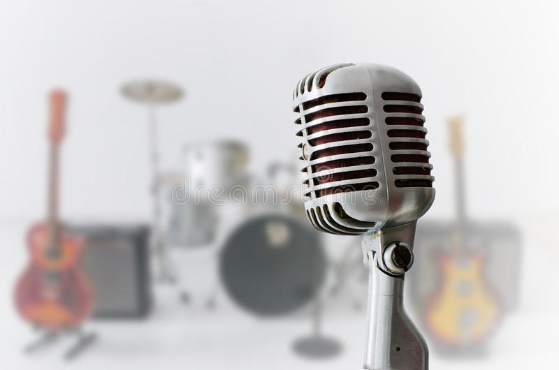 Old Chrome microphone and Blur musical instrument. Background royalty free stock photography
