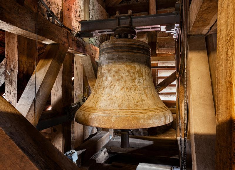 Old Church bell. And mounting construction stock photography
