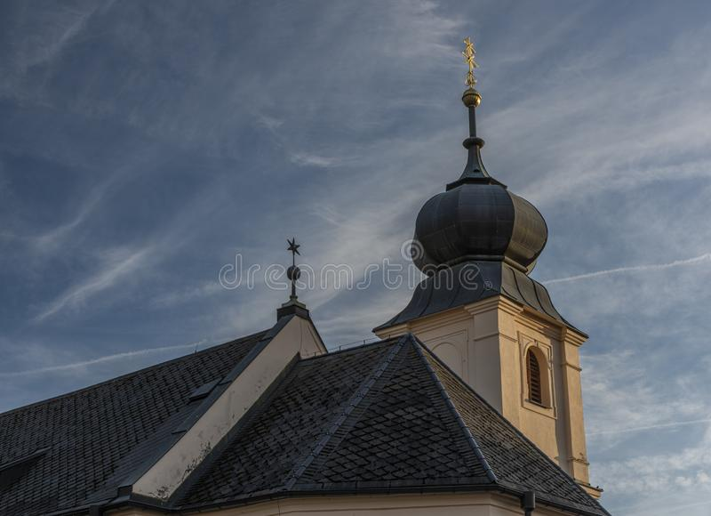 Old church with blue sky in Besiny village in autumn evening. Old church with blue sky in Besiny village in autumn color evening beautiful beauty bohemia royalty free stock photo