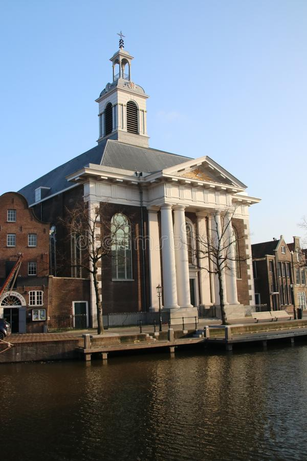 Old church building in the center of Schiedam, The Netherlands. Along the schie stock photos